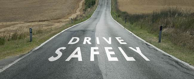 road with drive safely written on it