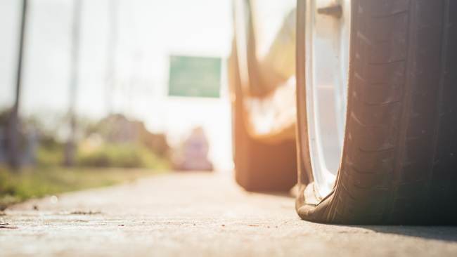 flat tyre on a road