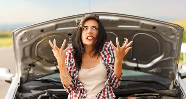 woman frustrated next to her car